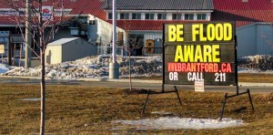 """BE FLOOD AWARE"" warns a City of Brantford mobilesign. By Nathanael Lewis."