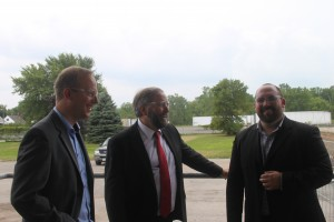 Federal NDP Leader Tom Mulcair (center) with Federal NDP candidate of record Marc Laferriere (right) and Hartmann North America president Torben Rosenkrantz- Theil (left) viewing the new factory wing currently under construction. Photo by Cody Groat.