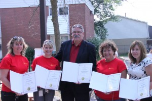 Dave levac presents certificates of thanks to volunteers. From left to right: Linda Ellis, Main Coordinator of Carnivals, Chris Hipkin, Housing coordinator, Dave Levac, Brant MPP, Ellen Gerow, Housing coordinator, Marsha Potvin, Property Manager COB. Photo by Nathanael Lewis.