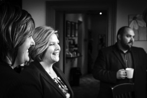 NDP representatives, Andrea Horwath(centre), along with Marc Laferriere (right) and Alex Felsky (left) speak with locals at the Blue Dog Cafe. (Photo by Nathanael Lewis)