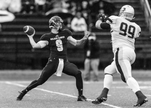 Laurier QB James Fracas threw for 214 yards and rushed for a touchdown in a losing cause to No. 2 ranked Western. (Photo courtesy of Thomas Kolodziej, Laurier Athletics)
