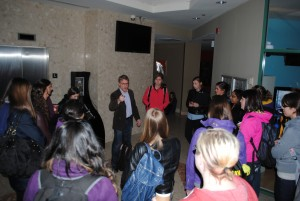 Dr. Haskell continues teaching his class in the hallway during the power outage.