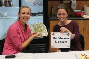 Kimberly Hamilton and Emily Embury of the Shakers and Bakers hold their winnings. Lyndsay Brown