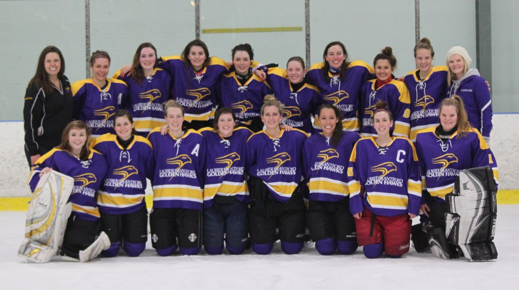 Laurier Brantford's womens hockey team posing after a victorious championship run. Chris Pimentel.