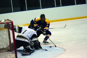 Dave Denardi drives towards the net against Humber, Laurier won the tournament by beating Humber 3-1. Photo by Chris Pimentel.