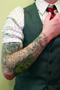 Kenneth Paul Lemoine with work attire and tattoos. By Caitlin Snider