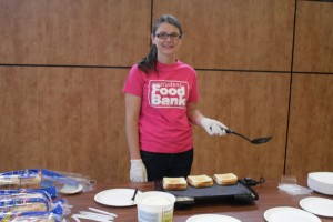 Kathleen Bee excited to be giving Laurier Brantford Students grilled cheese sandwiches. Photo by Taylor Berzins