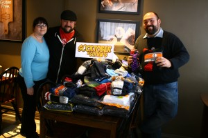 From left: Laura Duguid, Lucas Duguid, and Marc Laferriere organized Socktober at Sophia's. Photo by Cody Hoffman