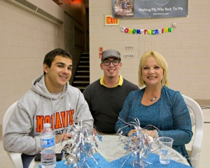 Joan Minnery, with her son B.J. and Miles Smith at her book release party. Photo courtesy of Heather Cardle