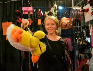 Features Editor Karly Rath holds a plush duck strapped into a suspension system used for BDSM. Photo by Layla Bozich