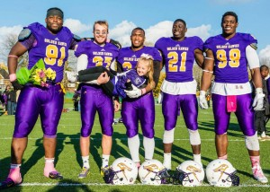 Left to right: Asante Mizan (91), Ronnie Pfeffer (37), Dillon Campbell (34), Chris Ackie (21), Ese Mrabure-Ajufo (99), with Pfeffer's cousin Ash after their final home game for the Laurier Golden Hawks. Photo courtesy of Kha Vo