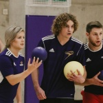 Laurier Brantford athletes gather with dodgeballs in hand mid-game, focusing on their opponents.