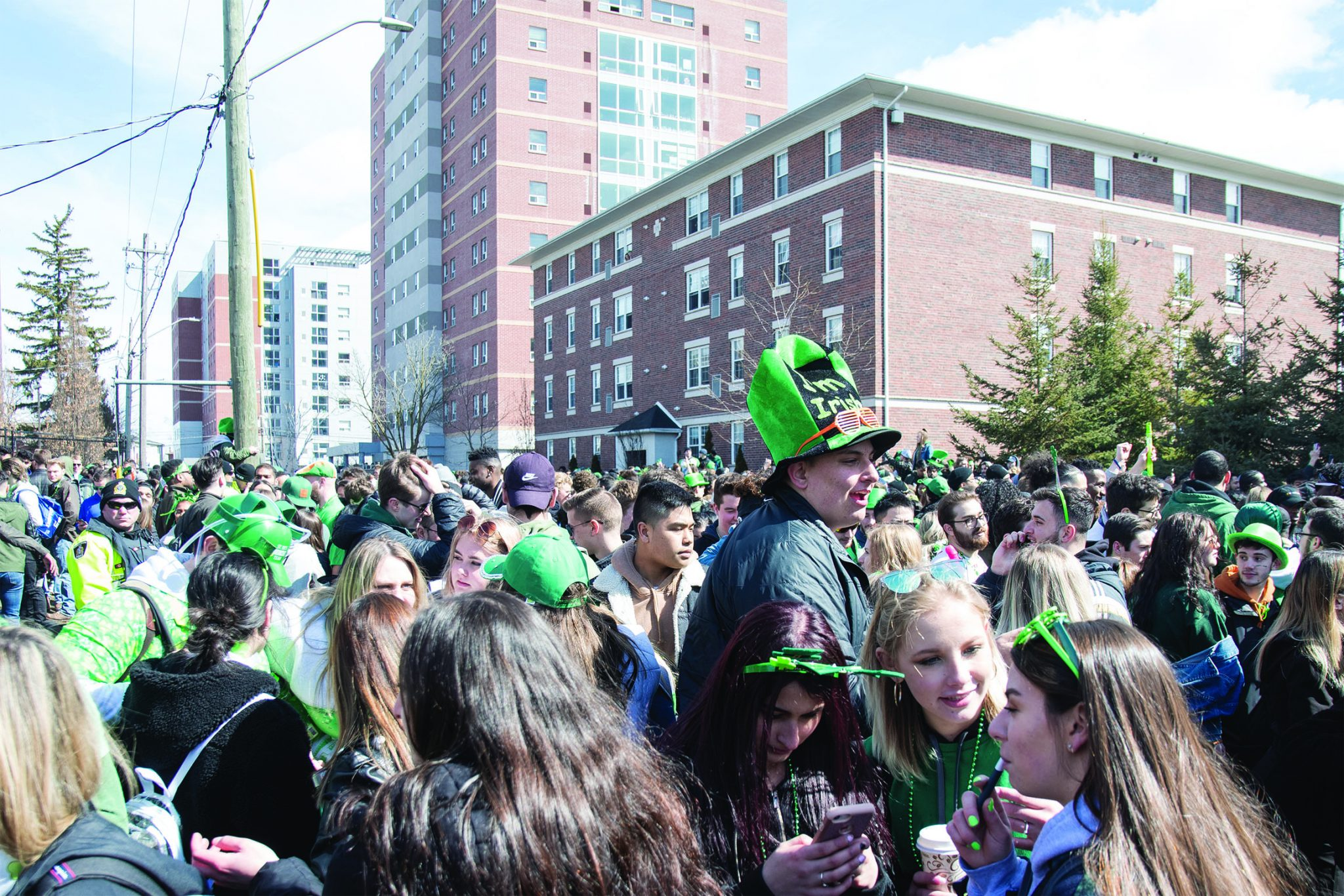Crowd celebrates Saint Patrick's Day on Ezra street.