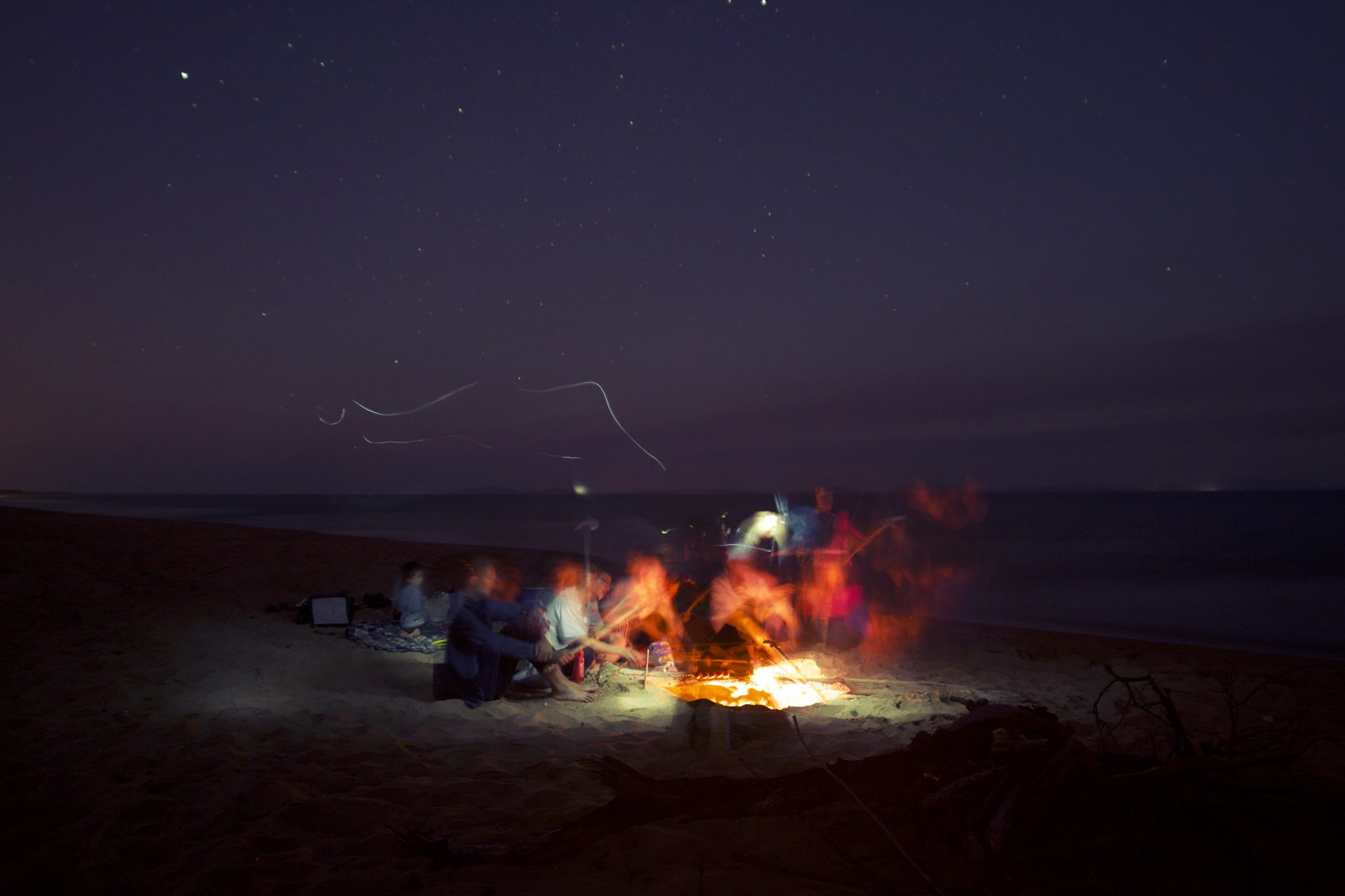 Group gathers around a bonfire